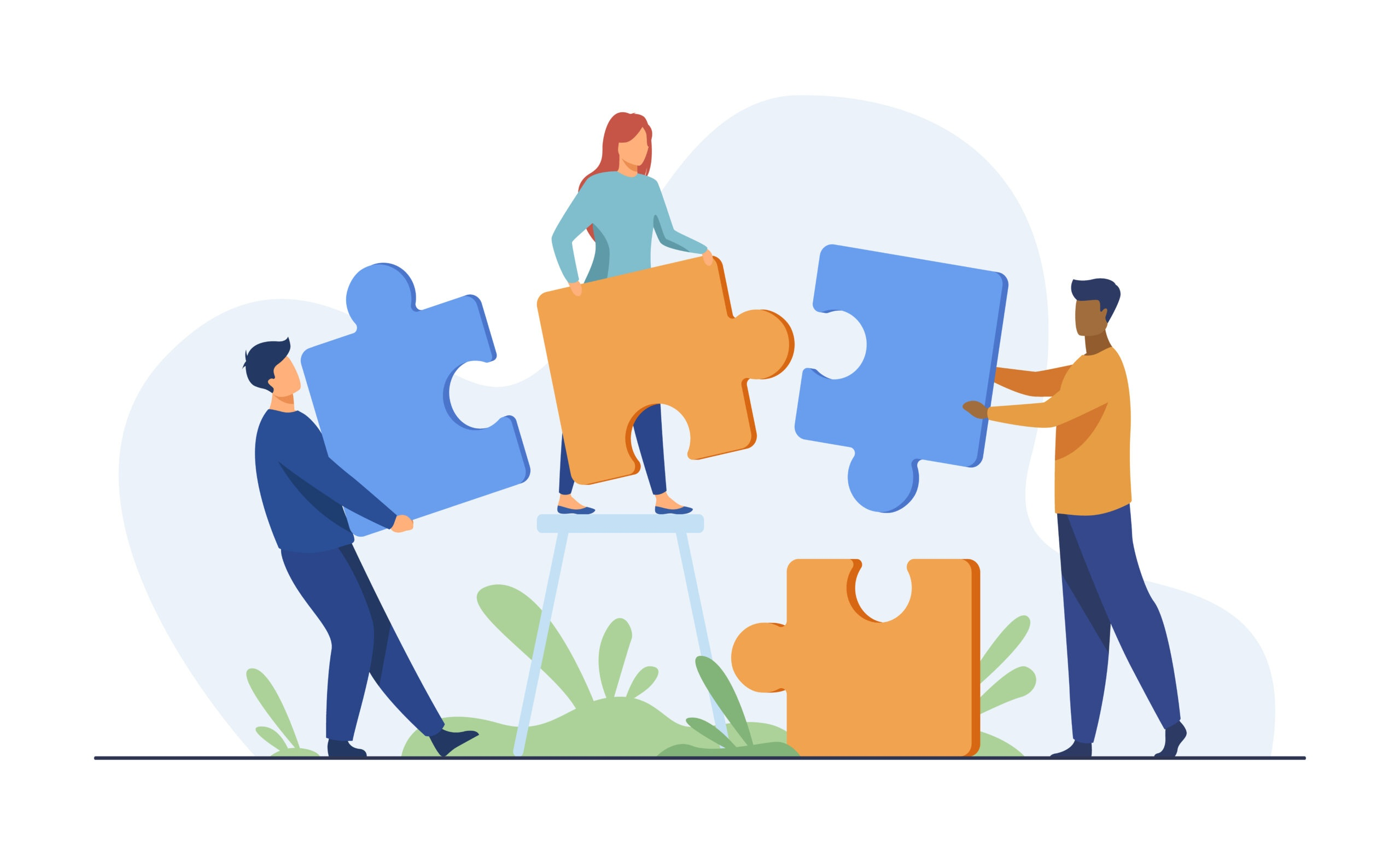 Partners holding big jigsaw puzzle pieces